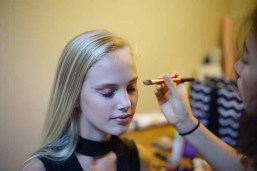 Behind the scenes, model Caelyn Calhoun has Hard Candy Metal Glaze makeup applied by Jade Soto