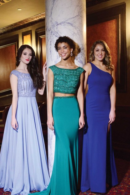 Lindiana Frangu, left, Kaliegh Garris, and Morgan Mancini in their Sherri Hill gowns. The gowns were provided by Dazzle Boutique in Oxford.