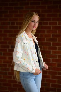 Model Caelyn Calhoun wears a coat in cream from Target. Blouse, slacks, and shoes are the model's own.