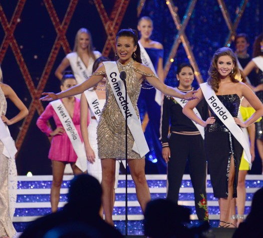 Miss Connecticut Bridget Oei introduces herself during the opening of night 2 of preliminary competitions at Miss America last year in 2018. The competition is moving to the Mohegan Sun this December. (MIKE CHAIKEN PHOTO)
