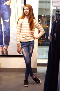 Katerina wears a blouse from Poof Girl and jeans from Free Style.