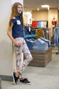 Katerina wears a blouse from One Step Up and slacks from Star Ride.