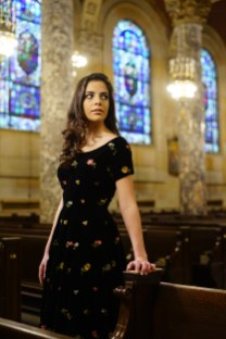 A.M. Eight Track Vintage provided this outfit for Monika Korbusieski of Wolcott. Waterbury fashion stylist Hannah Vitarelli said, 'This 1950's beauty is a modest cut with beautiful floral embroidery.' Photographed on location at the Basilica of the Immaculate Conception in Waterbury, courtesy of Rev. Jim Sullivan.