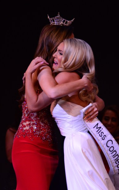 Jillian Duffy, left, learns she is the new Miss Connecticut.
