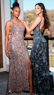 Aicha Diallo, left, wears a gown from Tiffany Designs and Allie Maisto wears a gown from Amarra.