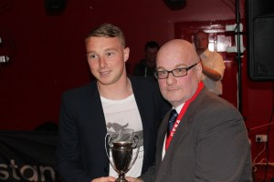 Player of the Year Nicky Adams looks a bit shellshocked after a strange bloke in a suit rings a bell in his ear....