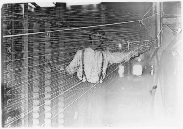 Illustrative photo of a warper at his machine.
