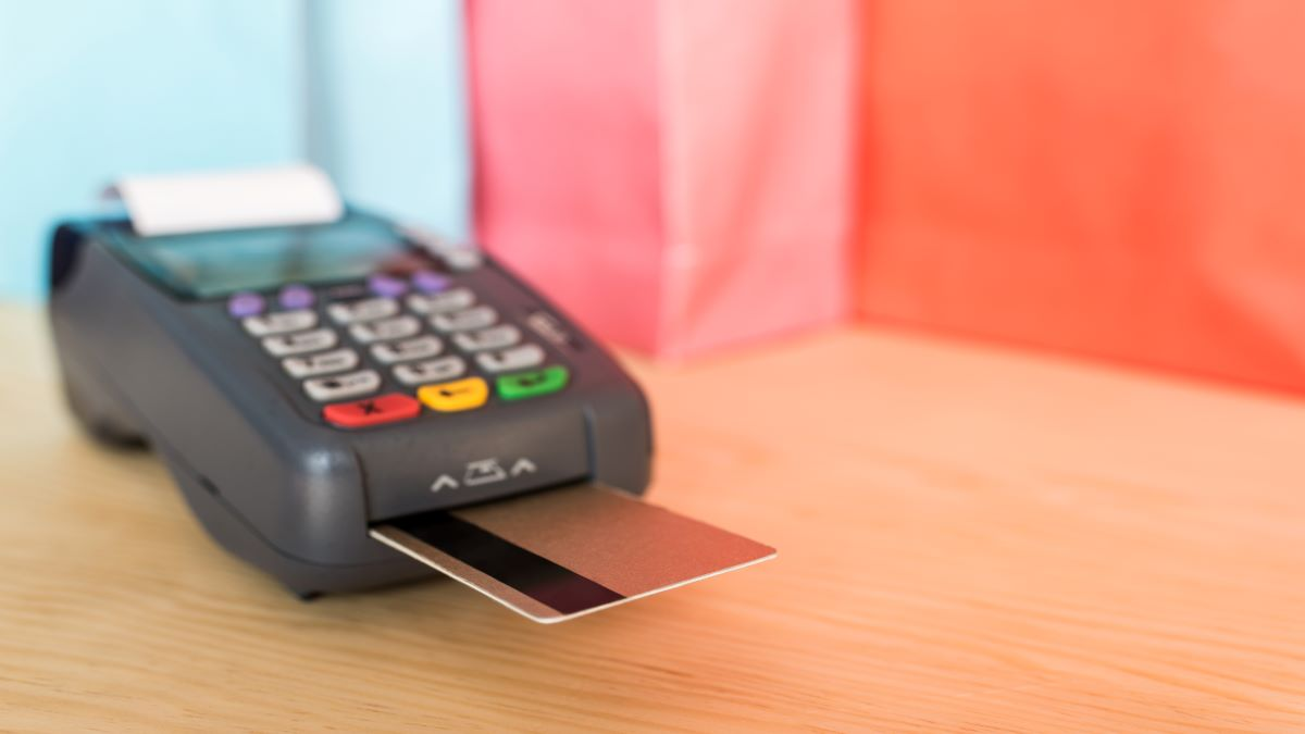 close-up-view-of-pos-terminal-with-credit-cards-AHSAZ3K