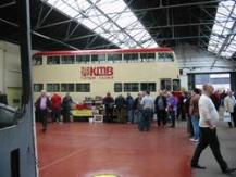 Visitors pile into the bus depot
