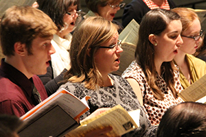 College students sing in Kramer Chapel