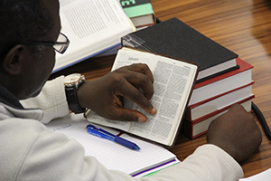 A student studies the book of Ephesians.