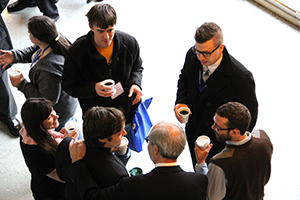 Potential students fellowship during coffee hour with Dr. Just.