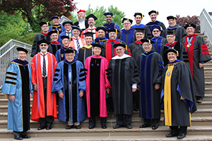 CTSFW Faculty Picture on the steps leading to the upper plaza during the 2018 Commencement.