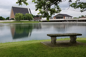 A view of our chapel from the bench on the opposite side of the lake.