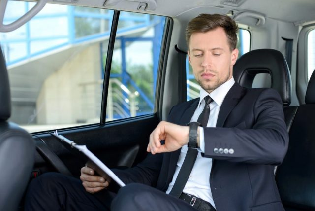 handsom man sit in luxury SUV in ct