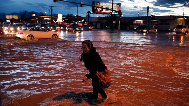 Woman walks through flood