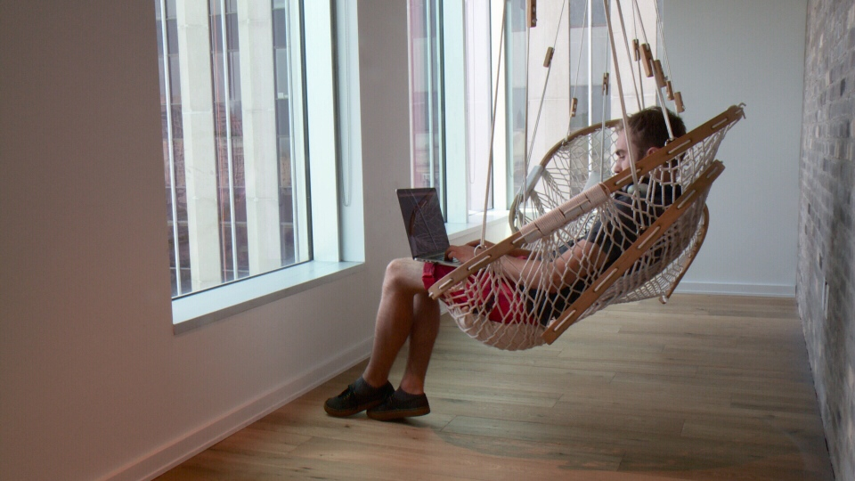 hammock chair stand calgary unfinished wood rocking runners a peak inside the headquarters of shopify ctv news ottawa worker swings from at in july 7 2015