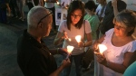 People light candles in Ponce, Puerto Rico, Monday, June 13, 2016, during a vigil for the victims of Sunday's Orlando shootings at a gay nightclub in Florida. At least 5 of the 49 victims were from Ponce, the second largest city on Puerto Rico's southern coast. (Danica Coto/AP Photo)