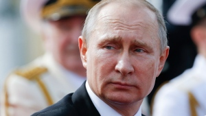 Russian President Vladimir Putin looks on attending the military parade during the Navy Day celebration in St.Petersburg, Russia, on Sunday, July 30, 2017. (AP Photo / Alexander Zemlianichenko, Pool)