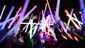 'Star Wars' fans raise glowing sabers together during the Glow Battle Tour stop at Grand Park on Friday, Dec. 15, 2017, in Los Angeles. (Photo by Chris Pizzello/Invision/AP)