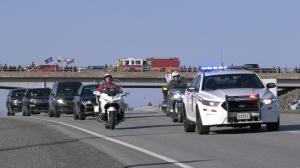 The motorcade bringing Sub-Lt. Abbigail Cowbrough home to Dartmouth drives along Highway 102 after leaving Halifax Stanfield International Airport on Monday evening. (CTV ATLANTIC / JIM KVAMMEN)