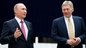 Russian President Vladimir Putin and his press secretary Dmitry Peskov, right, in Moscow, on June 15, 2017. (Alexander Zemlianichenko / AP)