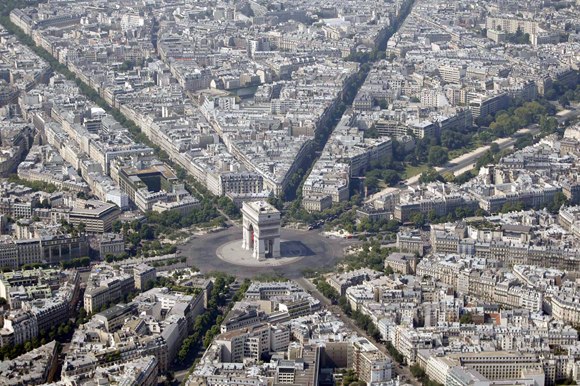 An aerial view shows the Arc de Triomphe and rooftops of residential buildings in Parisin Paris