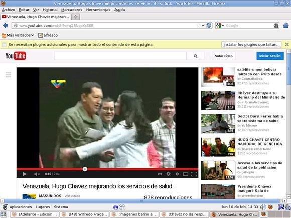 Oscar junto a Chávez en un acto.