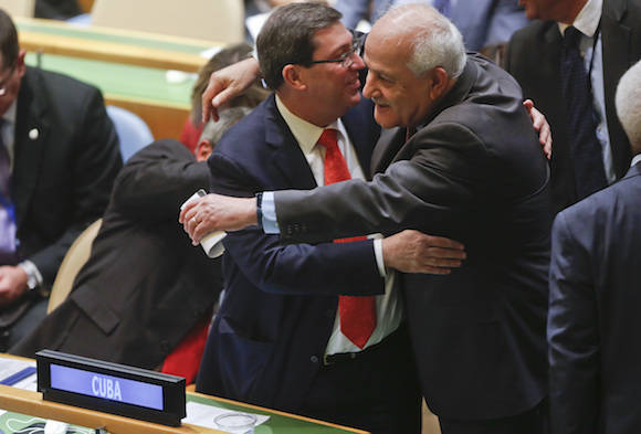 Palestinian Authority Ambassador to the U.N. Riyad Mansour, right, hugs Cuba's Foreign Minister Bruno Rodríguez after a resolution vote in the U.N. General Assembly, Wednesday Oct. 26, 2016 at U.N. headquarters. The United States has abstained for the first time in 25 years on a U.N. resolution condemning America's economic embargo against Cuba, a measure it had always vehemently opposed. (AP Photo/Bebeto Matthews)