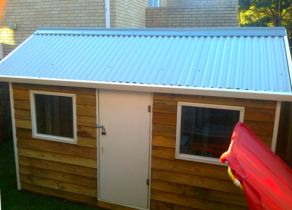 cubby house 2.4m x 1.8m, two perspex windows, plywood door, painted trim $1265