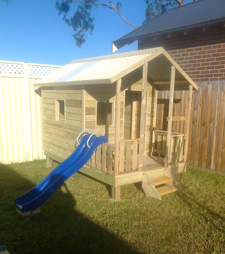 cubby house 2.8m x 1.8m with deck, side rails, x2 window openings, slide, 40cm elevation $2190 Installed