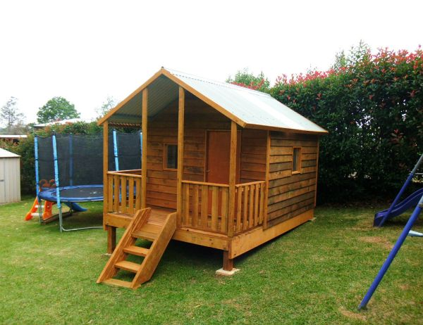 large cubby house with verandah 2.8m x 2.4m, stained, x2 perspex windows, ply door, side rails, 50cm elevation $2725 with accessories