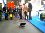 Rover at Mobile World Congress attracting crowd of people.