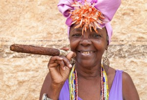 woman-with-typical-clothes-and-a-huge-cuban-cigar-in-havana-cuba-LK-1170x800