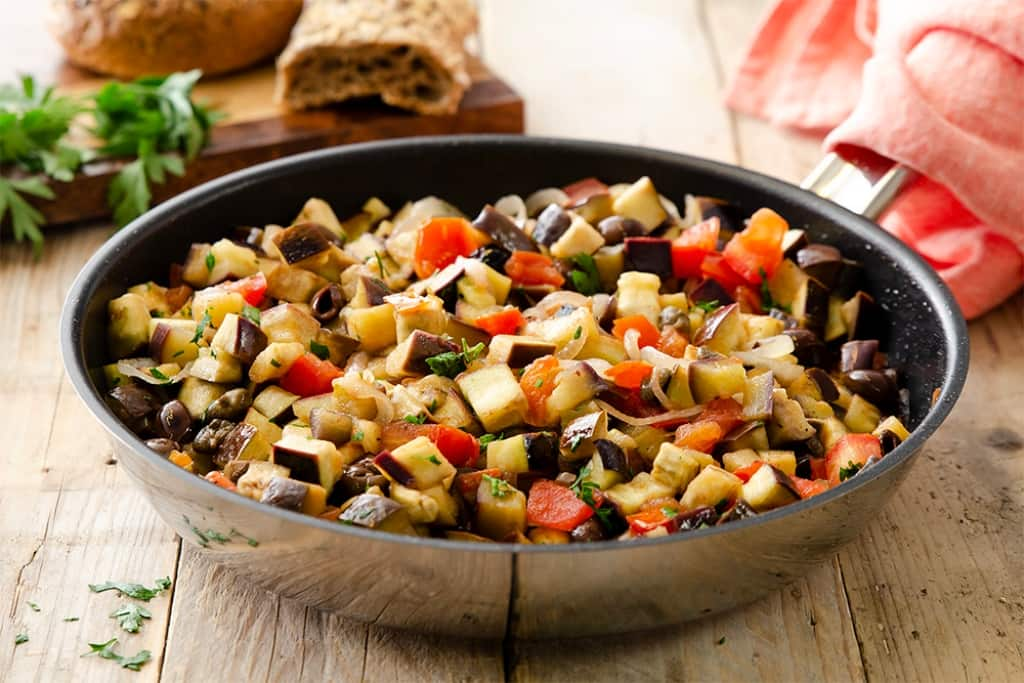 Ricetta Melanzane in padella con olive e capperi  Cucchiaio dArgento