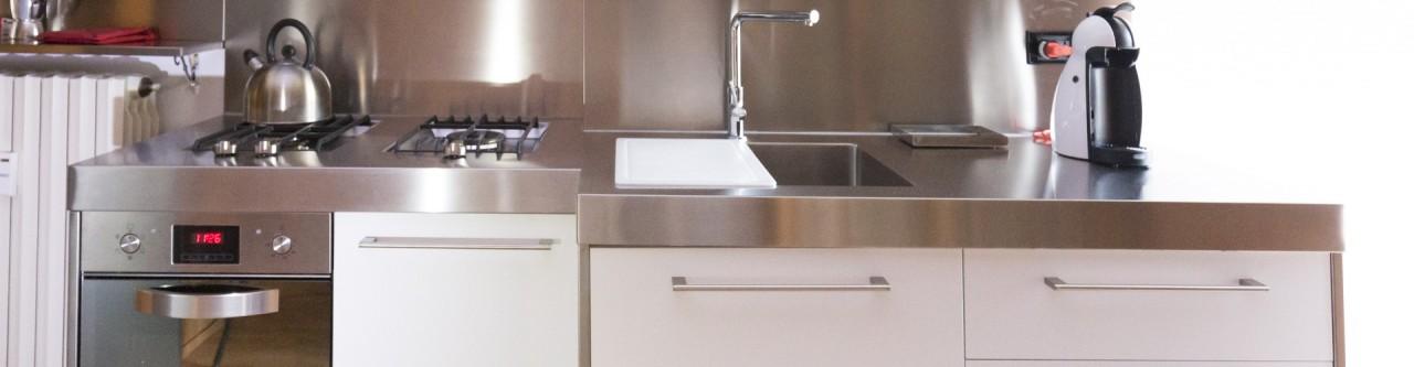 Cucina acciaio inox top sagomato  Progetti Borlina Acciaio