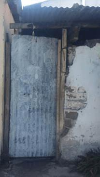 Puerta de ingreso sacristia y muro de cerramiento Ermita Santa Lucia
