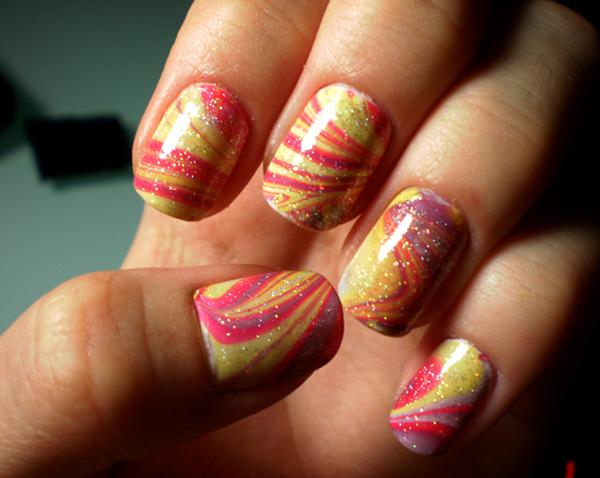 Paint Your Nails In Abstract Colors Using Water Marble Nail Art Design Blue