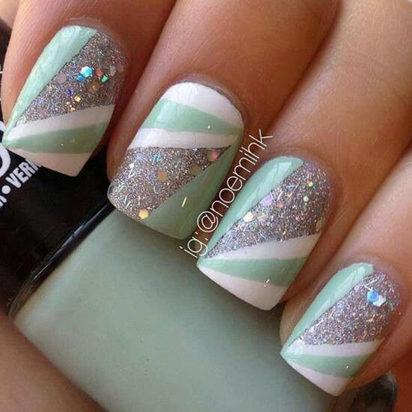 Abstract Themed Glitter Nail Art Design In Silver With White And Light Green Polish