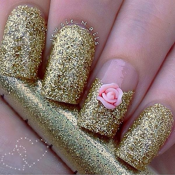 Ravishing In Gold Glitter Nail Art Topped With A Pink Flower Detail