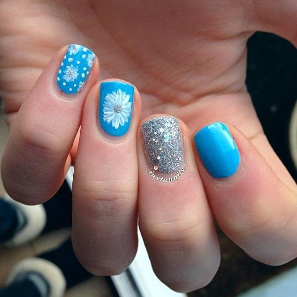 Sky Blue Nail Art With Studs Design Idea