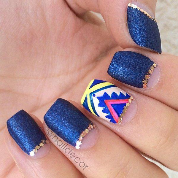 You can now put blue glitters for all your nails without thinking if it's too much. It will instantly be toned down by a half moon design as well as an accent with a different design.