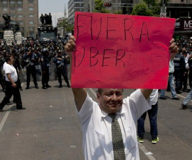 A taxi driver in Mexico City protests against Uber.