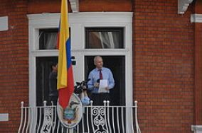 Assange reading a statement from the embassy balcony in 2013.