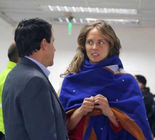 Manuela Picq talks to her attorney Friday at a Quito immigration office