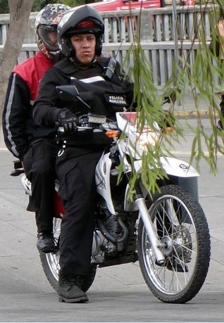 Cuenca: two police, one motorcycle. USA: zero chance.