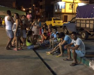 Residents gather in the street following latest quake.