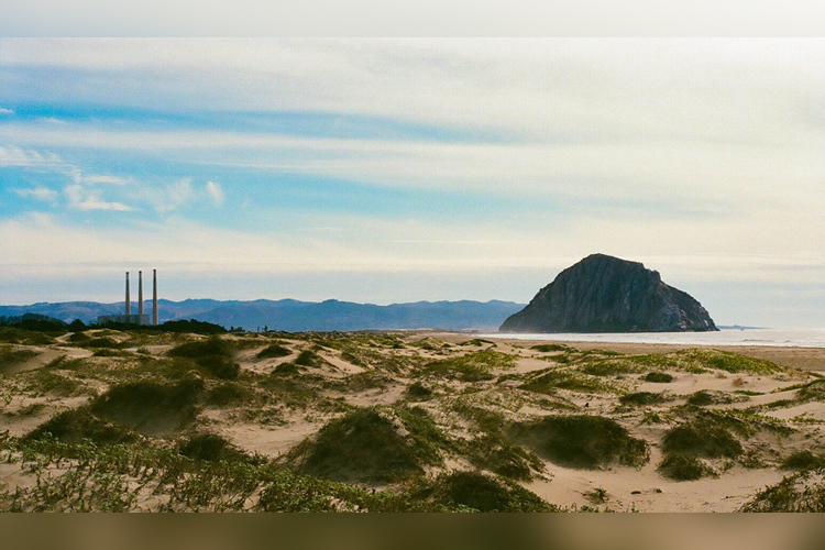 Three smoke stacks and Morro Rock from the dune area on Morro Strand Beach.
