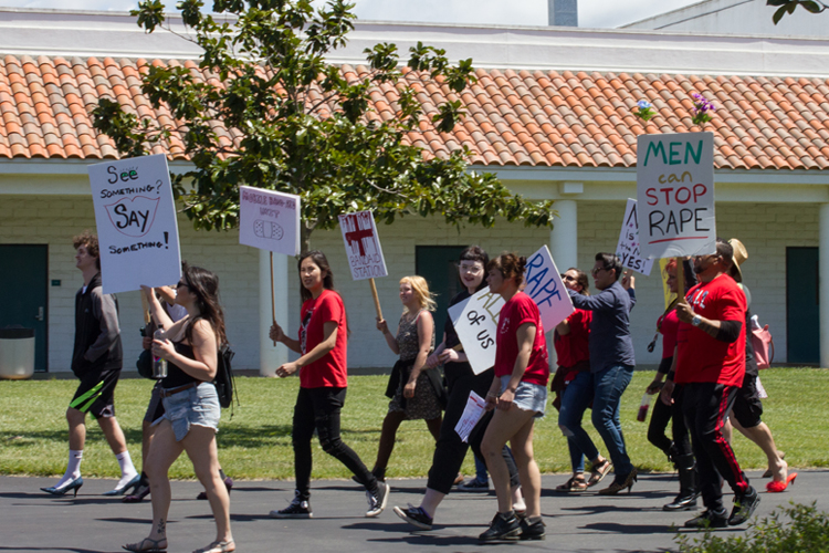 Men and women strut high heels on the one mile march across campus.