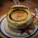 Lobster Bisque served in a mini roasted sugar pumpkin with Asiago croutons